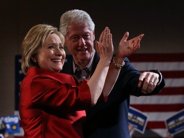 Democratic presidential candidate former Secretary of State Hillary Clinton and her husband former U.S. president Bill Clinton greet supporters during a caucus day event at Caesers Palace on February 20, 2016 in Las Vegas, Nevada.