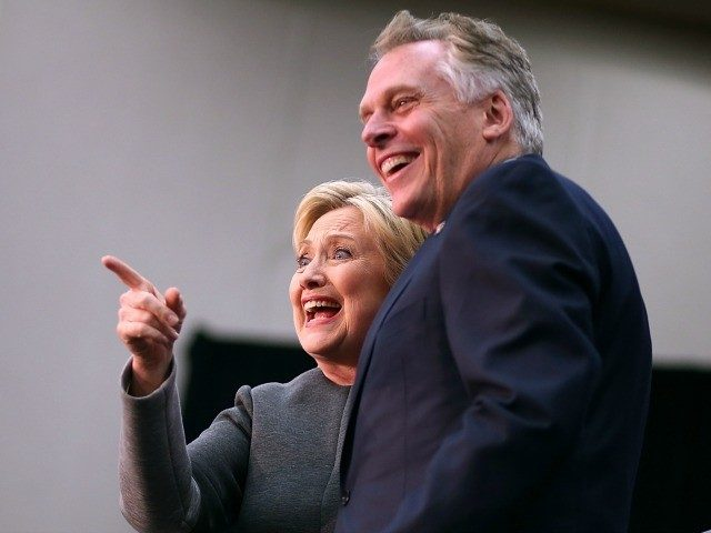 Hillary Clinton greets supporters with Virginia Gov. Terry McAuliffe February 29, 2016 in Fairfax, Virginia.