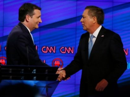 Senator Ted Cruz (C) and Ohio Governor John Kasich (R) shake hands following the CNN Republican Presidential Debate March 10, 2016