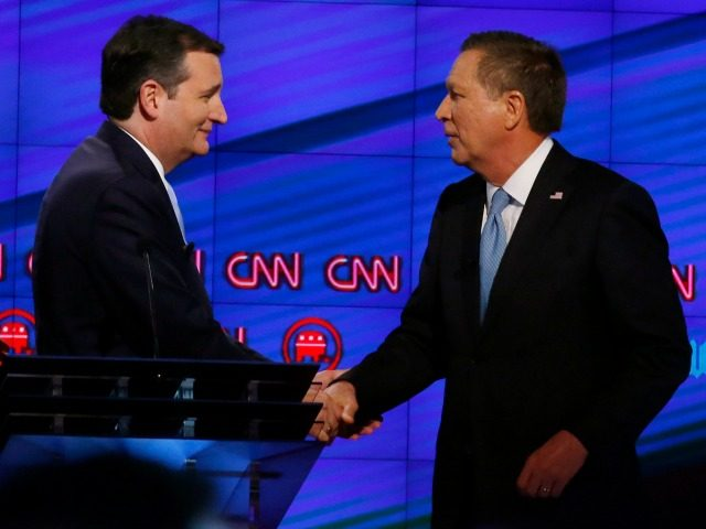 Senator Ted Cruz (C) and Ohio Governor John Kasich (R) shake hands following the CNN Republican Presidential Debate March 10, 2016