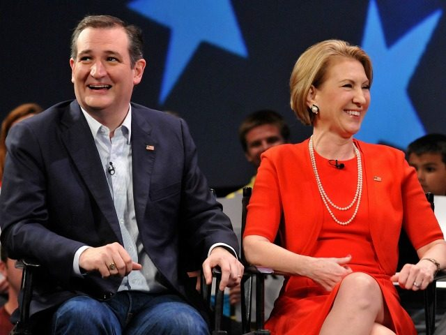 Republican presidential candidate Sen. Ted Cruz (R-TX) and former candidate Carly Fiorina (L) in a discussion with political commentator Sean Hannity during a campaign rally at Faith Assembly of God Church on March 11, 2016 in Orlando, Florida.