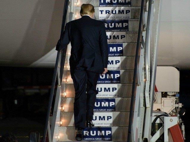 Donald Trump boards his plane following a rally on March 14, 2016 in Vienna Center, Ohio.
