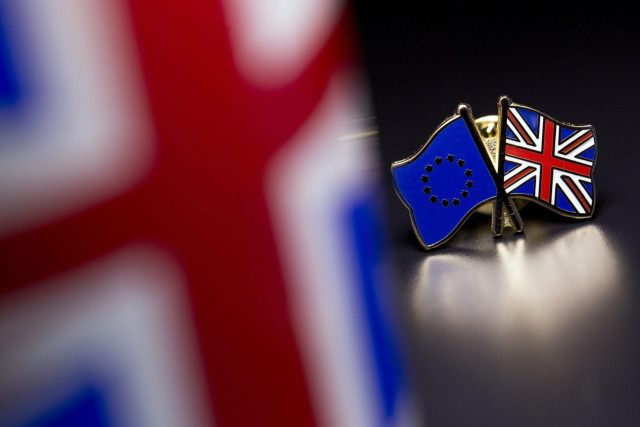 LONDON, UNITED KINGDOM - MARCH 17: In this photo illustration, the European Union and the Union flag are pictured on a pin badge on March 17, 2016 in London, United Kingdom. The United Kingdom will hold a referendum on June 23, 2016 to decide whether or not to remain a …