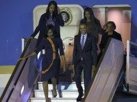 Barack Obama and First Lady Michelle Obama arrive with their daughters Sasha and Malia on March 23, 2016.