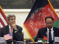 U.S. Secretary of State John Kerry (L) listens on as Afghan Foreign Minister, Salahuddin Rabbani, speaks during a conference, in Kabul, on April 9, 2016. / AFP / POOL / MASSOUD HOSSAINI (Photo credit should read MASSOUD HOSSAINI/AFP/Getty Images)