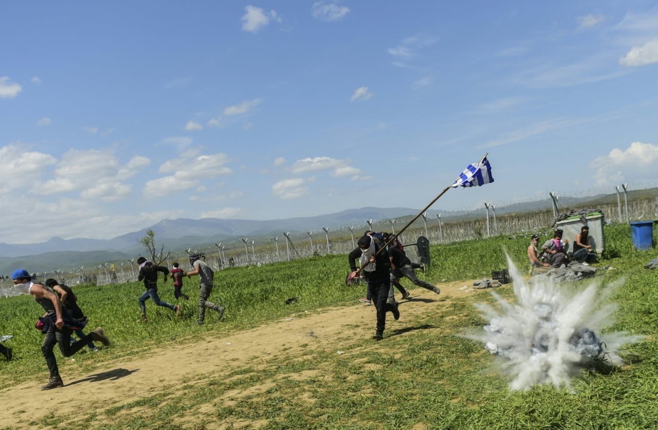 A tear gas cannister explodes (BULENT KILIC/AFP/Getty Images)