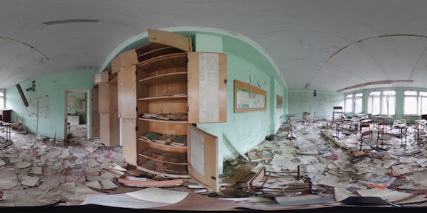 PRIPYAT, UKRAINE - APRIL 09: (EDITOR'S NOTE: Image was created as an Equirectangular Panorama. Import image into a panoramic player to create an interactive 360 degree view.) Books lie strewn across the floor in a former classroom in elementary school number three on April 9, 2016 in Pripyat, Ukraine. Pripyat, built in the 1970s as a model Soviet city to house the workers and families of the Chernobyl nuclear power plant, now stands abandoned inside the Chernobyl Exclusion Zone, a restricted zone contaminated by radiation from the 1986 meltdown of reactor number four at the nearby Chernobyl plant in the world's worst civilian nuclear accident that spewed radiaoactive fallout across the globe. Authorities evacuated approximately 43,000 people from Pripyat in the days following the disaster and the city, with its high-rise apartment buildings, hospital, shops, schools, restaurants, cultural center and sports facilities, has remained a ghost-town ever since. The world will soon commemorate the 30th anniversary of the April 26, 1986 Chernobyl disaster. (Photo by Sean Gallup/Getty Images)