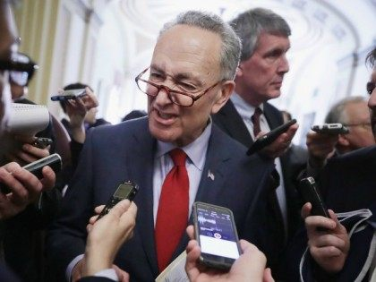 Sen. Charles Schumer (D-NY) speaks to reporters following the weekly Senate Democratic policy luncheon at the U.S. Capitol April 12, 2016 in Washington, DC.