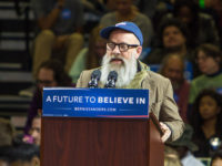 POUGHKEEPSIE, NEW YORK - APRIL 12: Michael Stipe speaks at Senator Bernie Sanders rally at McCann Arena at Marist College on April 12, 2016 in Poughkeepsie, New York. (Photo by Kenneth Gabrielsen/Getty Images)