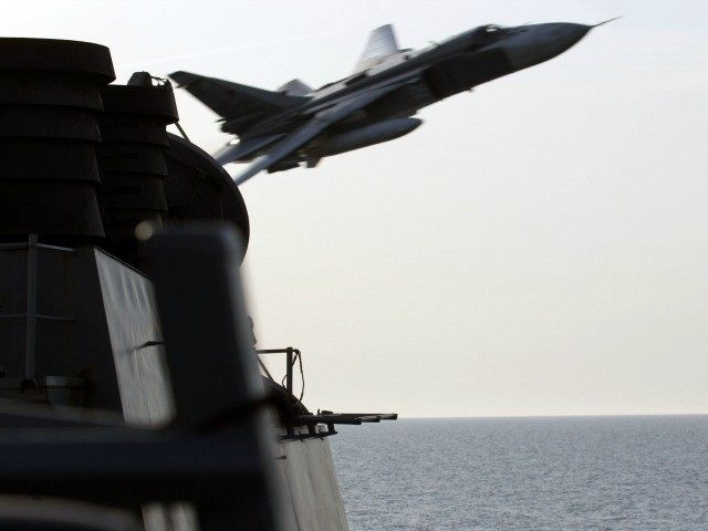 In this handout photo provided by the U.S. Navy, A Russian Sukhoi Su-24 attack aircraft makes a very low altitude pass by USS Donald Cook (DDG 75) on April 12, 2016 in the Baltic Sea. Donald Cook, an Arleigh Burke-class guided-missile destroyer forward deployed to Rota, Spain, is conducting a …