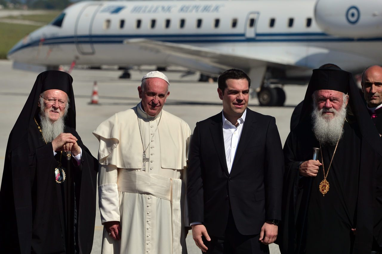 Pope Francis (2nd-L) poses with Greek Prime Minister Alexis Tsipras (2nd-R), Archbishop of Constantinople and Ecumenical Patriarch Bartholomew I (L) and Archbishop of Athens and All Greece Ieronymos II (R) (LOUISA GOULIAMAKI/AFP/Getty Images)