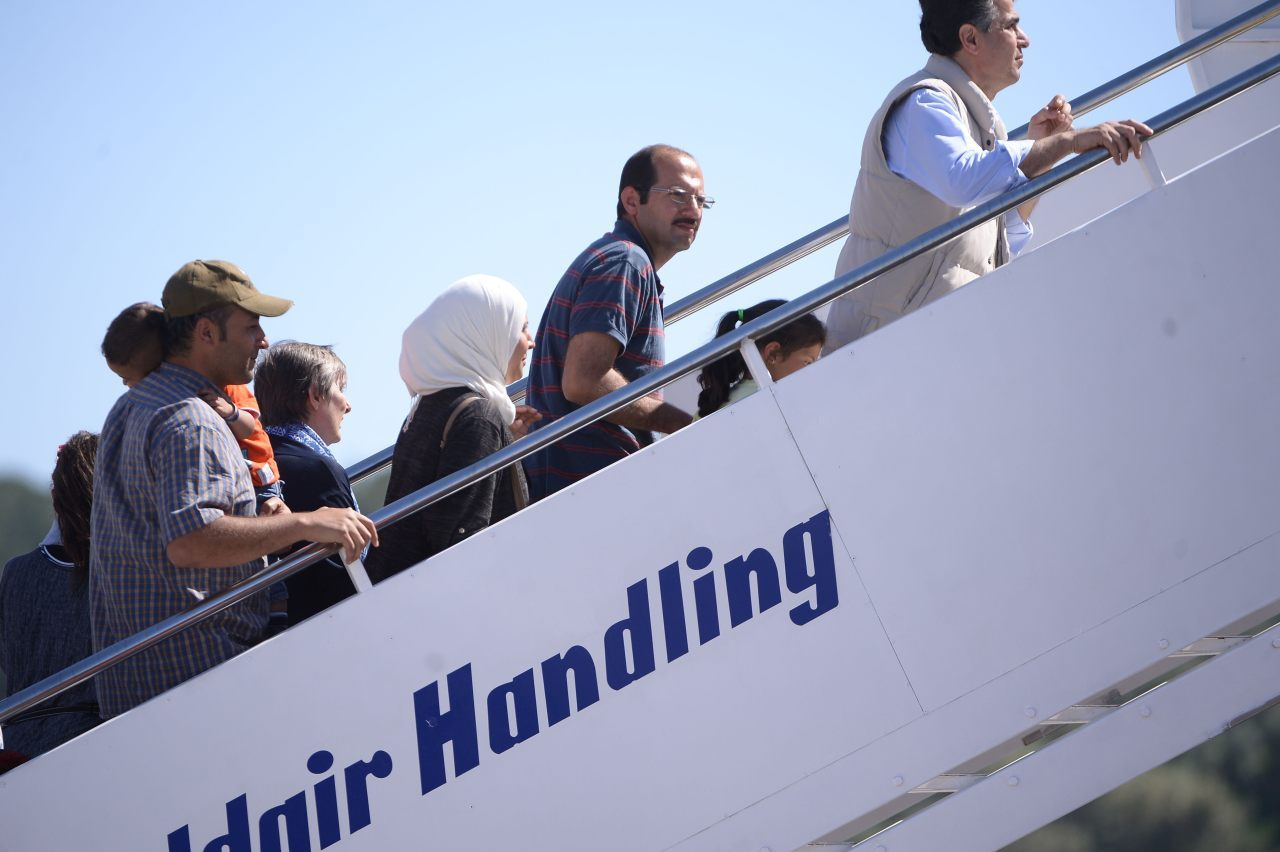 A group of Syrian migrants board the plane with Pope Francis (FILIPPO MONTEFORTE/AFP/Getty Images)