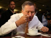 Republican presidential candidate John Kasich eats soup while having lunch at PJ Bernstein's Deli Restaurant on April 16, 2016 in New York City.