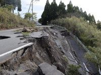 The picture shows a road damaged by earthquakes in Minami-Aso, Kumamoto prefecture, on April 17, 2016. At least 41 people are known to have died in the double disaster, with up to eight still missing -- feared buried in shattered houses or under torrents of mud. / AFP / KAZUHIRO …