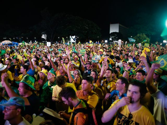 SAO PAULO, BRAZIL - APRIL 17: Protesters opposed to the impeachment of President Dilma Rousseff watch the voting session on television from within the central regions April 17, 2016 in Sao Paulo, Brazil. The Lower House of Congress will hold a vote on whether to impeach Rousseff over charges of manipulating government accounts for political gains. (Photo by Igo Estrela/Getty Images)