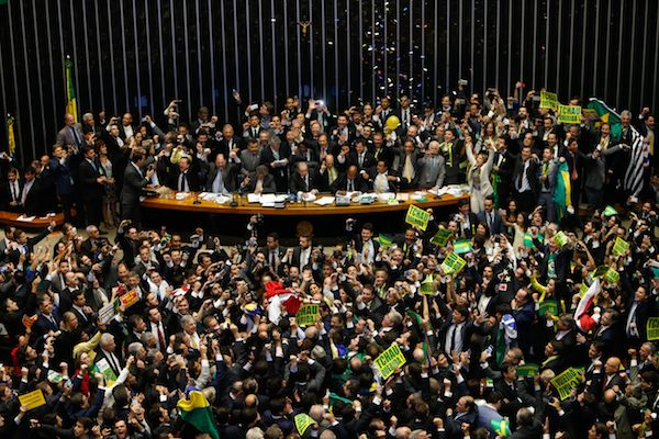 BRASILIA, BRAZIL - APRIL 17: Deputies of the Lower House of Congress vote on whether to impeach President Dilma Rousseff, April 17, 2016 in Brasilia, Brazil. The vote will decide whether to impeach Rousseff over charges of manipulating government accounts for political gains. (Photo by Igo Estrela/Getty Images)