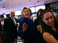 : Democratic presidential candidate, former U.S. Secretary of State Hillary Clinton greets patrons at Queens Crossing mall on April 17, 2016 in the Queens borough of New York City. The Democratic and Republican primaries in New York are tomorrow. (Photo by
