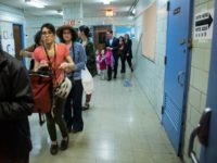 People line up to check into their voting station at Public School 321 on April 19, 2016 in the Brooklyn borough of New York City.
