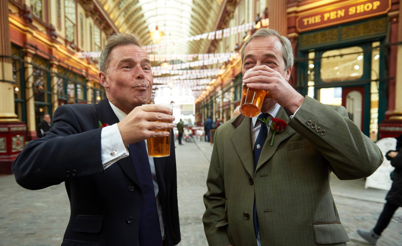 UK Independence Party (UKIP) London mayoral candidate Peter Whittle (L) and UKIP leader Nigel Farage (R) drink pints of beer as they attend a St George's Day celebration in Leadenhall Market in London on April 22, 2016 Saint George's Day is the feast day of Saint George, the patron saint of England, in Christian tradition. Nigel Farage called for St George's Day to be a national bank holiday. / AFP / NIKLAS HALLE'N        (Photo credit should read NIKLAS HALLE'N/AFP/Getty Images)