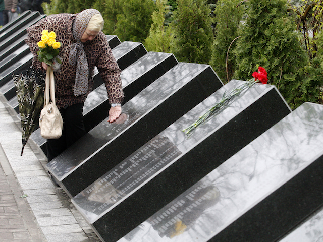 A woman mourns at the Chernobyl victims' memorial in the Ukrainian capital of Kiev on April 26, 2016. Ukraine marks 30 years since the world's worst nuclear accident at Chernobyl killed thousands and forced a global rethink about the wisdom of relying on atomic fuel. / AFP / Anatolii Stepanov (Photo credit should read ANATOLII STEPANOV/AFP/Getty Images)