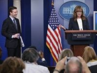 Actress Allison Janney (R) speaks as she shows up to surprise members of the press crops at the James Brady Press Briefing Room of the White House as press secretary Josh Earnest (L) looks on April 29, 2016 in Washington, DC