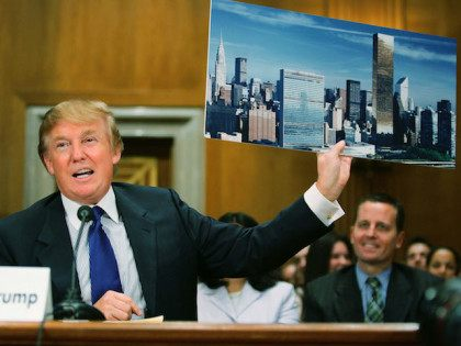 WASHINGTON - JULY 21: Donald Trump, president of the Trump Organization, displays a picture of the New York City skyline showing his Trump World Tower (R) near the United Nations as he testifies before the Federal Financial Management, Government Information, and International Security Subcommittee Capitol Hill July 21, 2005 in …