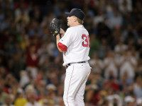 BOSTON, MA - JULY 14:  Curt Schilling #38 of the Boston Red Sox pitches during the game with the New York Yankees at Fenway Park on July 14, 2005 in Boston, Massachusetts. Schilling blew his first save 8-6 on a walk-off home run by Alex Rodriguez.  (Photo by Jim McIsaac/Getty Images)     *** Local Caption *** Curt Schilling