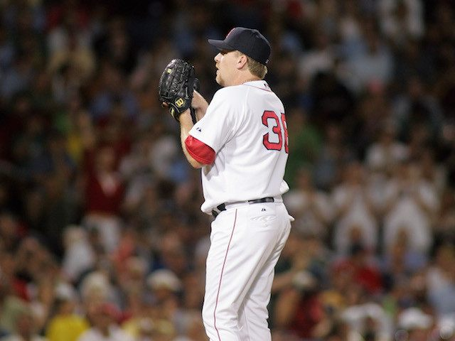 BOSTON, MA - JULY 14: Curt Schilling #38 of the Boston Red Sox pitches during the game with the New York Yankees at Fenway Park on July 14, 2005 in Boston, Massachusetts. Schilling blew his first save 8-6 on a walk-off home run by Alex Rodriguez. (Photo by Jim McIsaac/Getty …