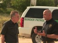 Glen Robertson with Border Patrol Agent Hector Garza on Border