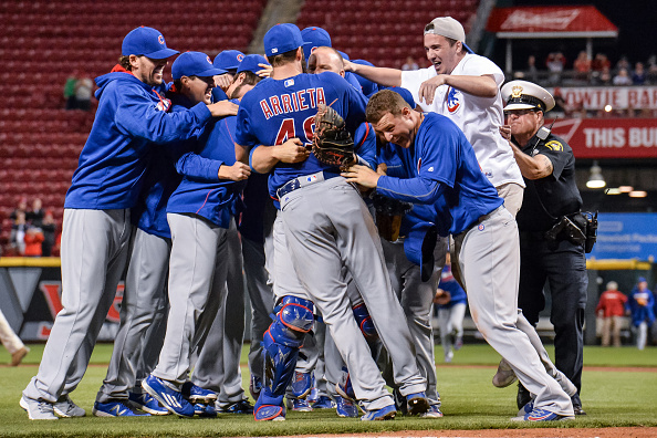 CINCINNATI, OH - APRIL 21: The Chicago Cubs and a fan celebrate with Jake Arrieta #49 of the Chicago Cubs after Arrieta pitched a no-hitter against the Cincinnati Reds at Great American Ball Park on April 21, 2016 in Cincinnati, Ohio. (Photo by Jamie Sabau/Getty Images)