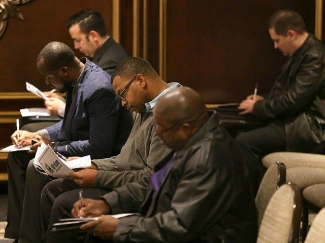 Job seekers fill out paperwork during the HireLive Career Fair on November 12, 2015 in San Francisco, California. The national unemployment rate stands at 5 percent. (Photo by )