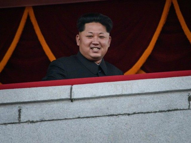 North Korea's leader Kim Jong-Un looks out towards Kim Il-Sung square during a mass military parade in Pyongyang on October 10, 2015. North Korea was marking the 70th anniversary of its ruling Workers' Party.