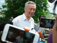 SINGAPORE - SEPTEMBER 11: Singapore Prime Minister and People's Action Party (PAP) Secretary General, Lee Hsien Loong speaks to the media after casting his vote at Alexandra Primary School on September 11, 2015 in Singapore.