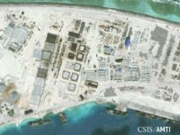 The northwest side of Mischief Reef showing a 1,900 foot seawall and newly-constructed infrastructure including housing, an artificial turf parade grounds, cement plants, and docking facilities are shown in this Center for Strategic and International Studies (CSIS) Asia... REUTERS/CSIS ASIA MARITIME TRANSPARENCY INITIATIVE/DIGITAL GLOBE/HANDOUT VIA REUTERS