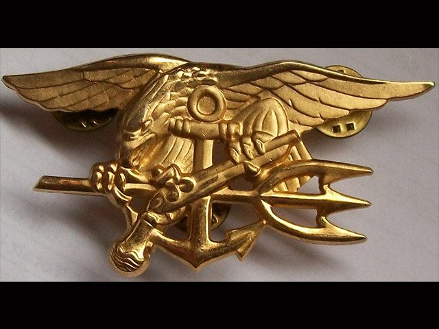 Taya Kyle Eagles Head Bowed On Seal Trident To Represent