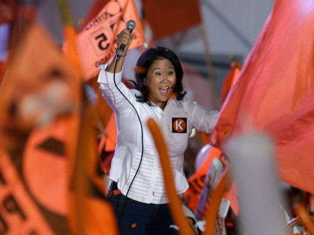 In this Thursday, April 7, 2016 photo, presidential candidate Keiko Fujimori waves at supporters during her closing presidential campaign rally in Lima, Peru. Keiko, the daughter of former President Alberto Fujimori, is the frontrunner in Peru's upcoming April 10 election. (AP Photo/Martin Mejia)