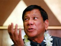 FILE - In this March 10, 2016 file photo, Davao City Mayor Rodrigo Duterte talks to the media prior to addressing seafarers organization in Manila, Philippines. The Australian ambassador and Philippine presidential candidates condemned Duterte's, the leading contender, remark made Tuesday, April 12, 2016, at a campaign rally that he …