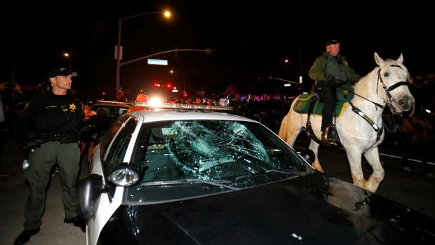 Police Car and horse anti-Trump protest CBS News