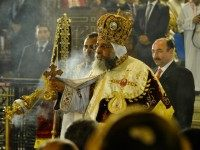 Leader of Egypt's Coptic Christians, Pope Tawadros II, (C) Head of the Egyptian Coptic Orthodox Church, leads the Coptic Christmas midnight mass at the al-Abasseya Cathedral in Cairo late on January 6, 2014.