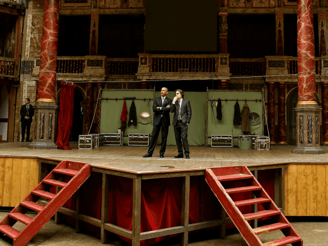 LONDON, UNITED KINGDOM - APRIL 23: US President Barack Obama is given a brief tour of the theatre by Patrick Spottiswoode, director of Globe Education during a visit to the Globe Theatre in London to mark the 400th anniversary of the death of William Shakespeare on April 23, 2016 in London, England.