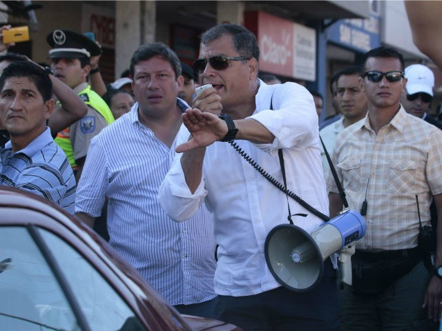 Ecuadorean President Rafael Correa (C) visits a disaster area in Montecristi, Ecuador on April 19, 2016. At least 413 people were killed when a powerful earthquake struck Ecuador on Saturday, destroying buildings and a bridge and sending terrified residents scrambling from their homes, authorities said Sunday. / AFP / Juan …