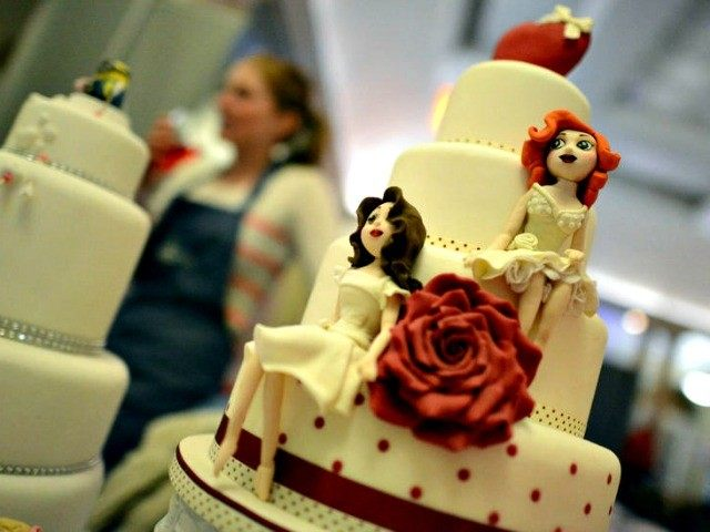 LEEDS, ENGLAND - MARCH 02 : A same sex wedding cake at the Gay Wedding Show at the Queens Hotel on March 2, 2014 in Leeds, England. Legislation to allow same-sex marriage in England and Wales was passed by Parliament in July 2013 and will come into force on March …