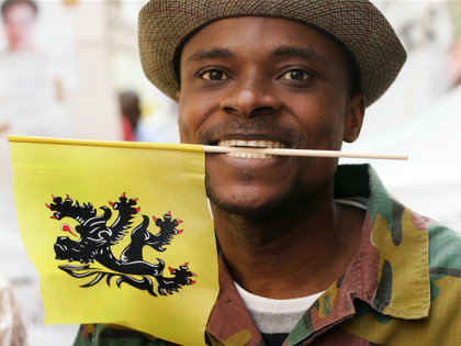 Congolese demontraters carrying the Flemish flag