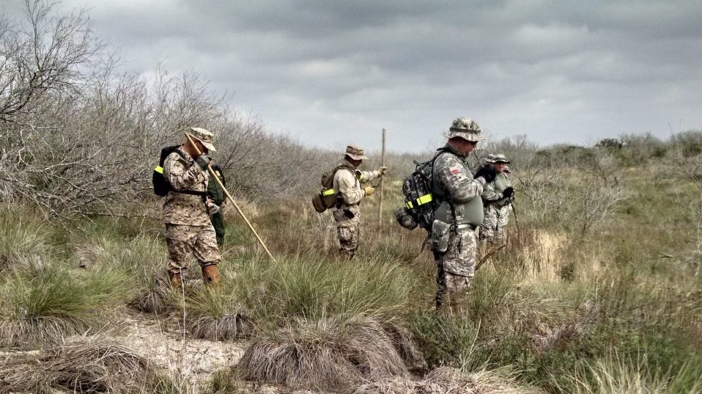 Members of the Texas State Guard searching ranch lands in Brooks County. (File Photo: Texas State Guard)