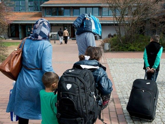 Refugees from Syria arrive at the Friedland shelter near Goettingen, central Germany, on April 4, 2016, after arriving from Turkey at the airport in Hanover.