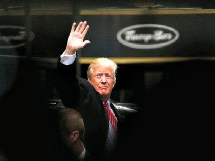 FILE - In this April 9, 2016 file photo, Republican presidential candidate Donald Trump acknowledges supporters while leaving Trump Tower in New York. Trump, Hillary Clinton and Bernie Sanders are all boasting about their New York City credentials. (AP Photo/Julio Cortez, File)