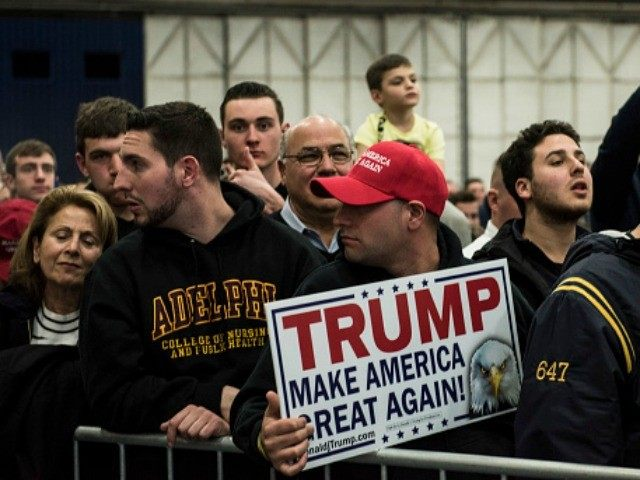Supporters listen to Republican Presidential Candidate Donald Trump prior to a campaign rally on April 6, 2016 in Bethpage, New York.