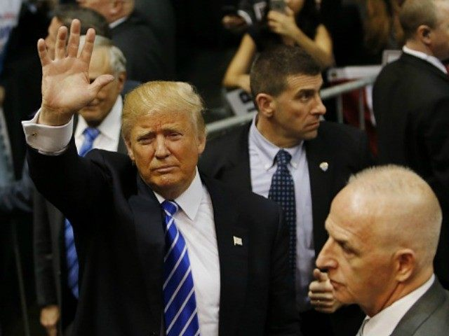 Republican presidential candidate Donald Trump greets supporters after speaking at a campaign rally on April 11, 2016 in Albany, New York.