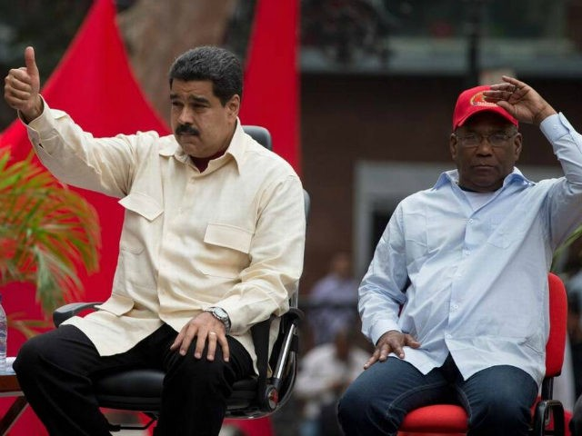 Venezuela's President Nicolas Maduro flashes a thumbs up sitting next to Vice President Aristobulo Isturiz during a ceremony marking the 206th anniversary of the call for independence from Spain, in Caracas, Venezuela, Tuesday, April 19, 2016. Opposition members are calling for Venezuelans to demonstrate across the country Tuesday to pressure …