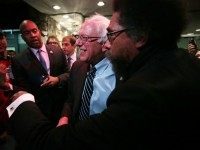 Philosopher Cornel West (R) greets Democratic presidential candidate Sen. Bernie Sanders (I-VT) at a watch party for the second Democratic presidential debate November 14, 2015 in Des Moines, Iowa